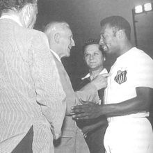 In July 1971, before a FC Santos match in Montreal, Gottfried Fuchs greeted world famous football star Pelé. To commemorate his ten-goal game in 1912, Fuchs was given the honor of kicking-off the match.